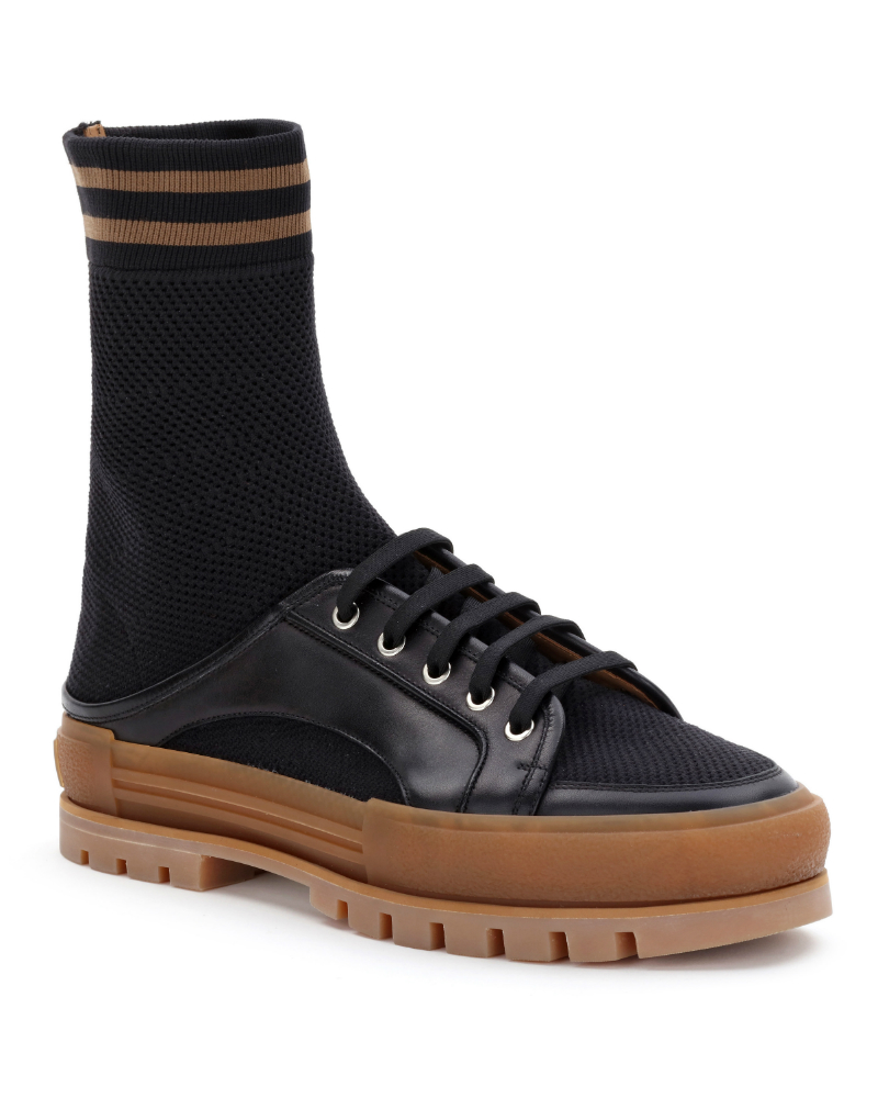 A surreal play on the heavy soled lace-up and sock combo.