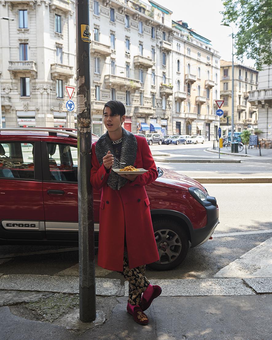Mario Maurer wears a cotton T-shirt, cashmere jacket with astrakhan fur collar, cotton-blend brocade trousers, cotton socks, velvet dress slippers, all by Dolce&Gabbana