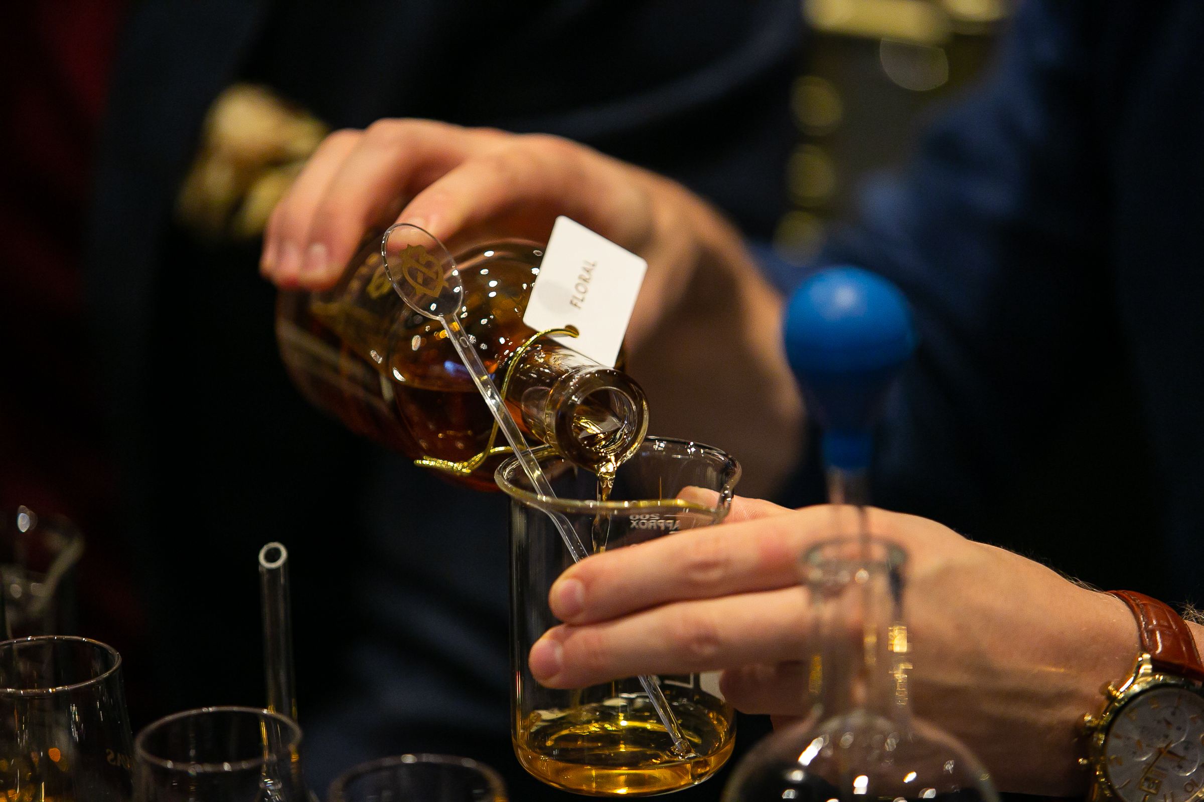 A workshop participant carefully blends his own whisky