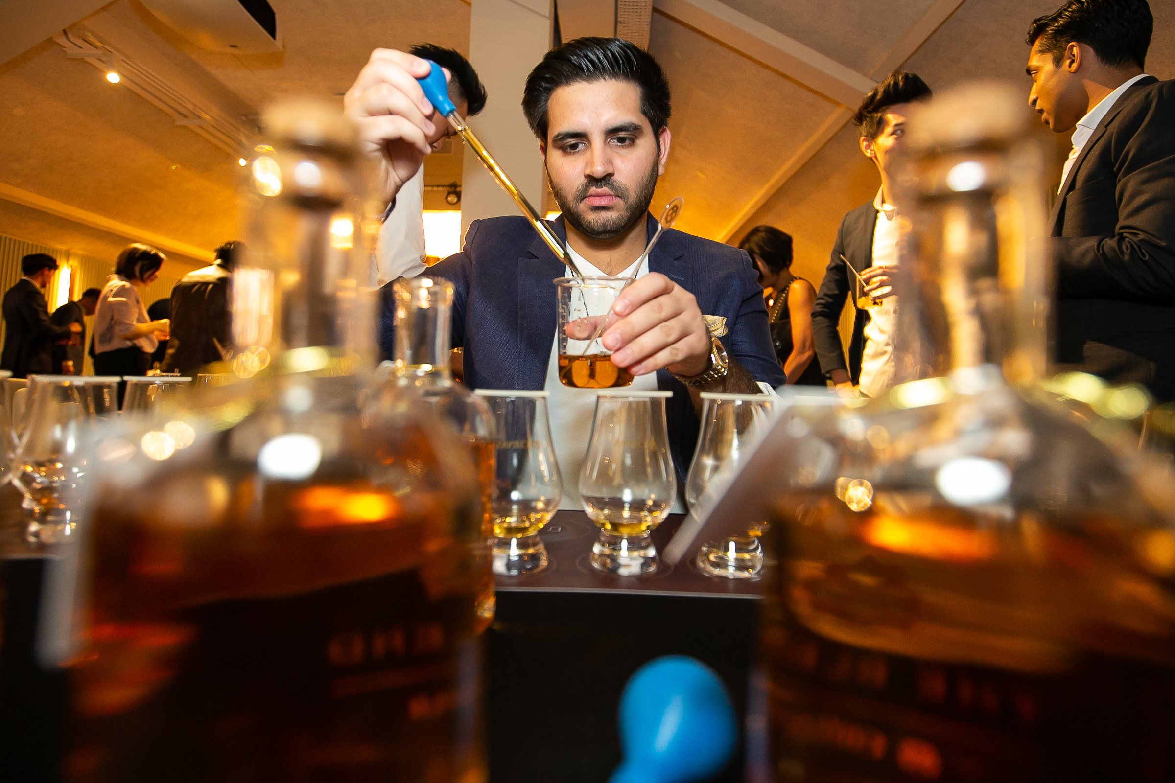 One of the participants carefully blending the whisky