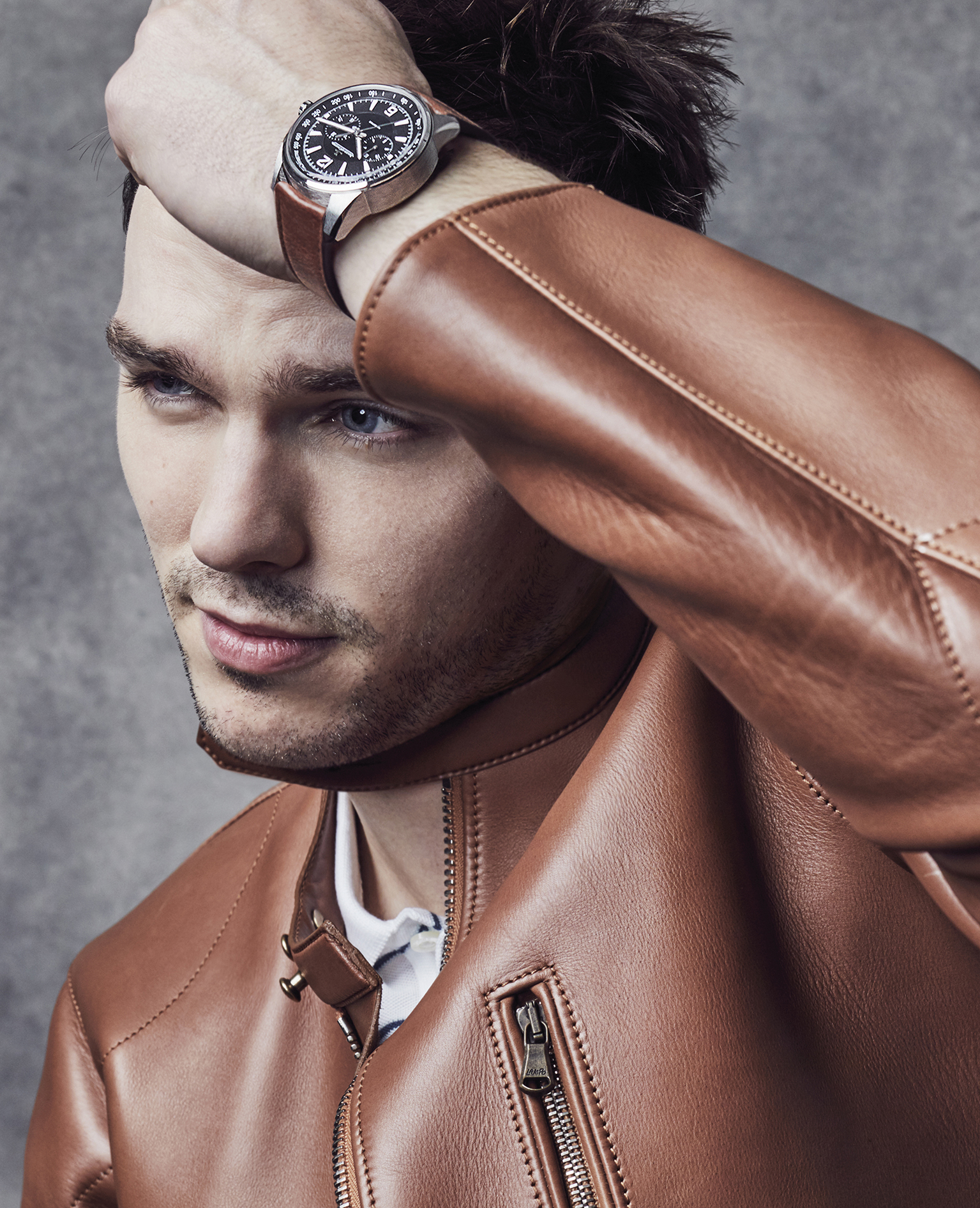 Nicholas Hoult is wearing a leather jacket from dunhill and the Jaeger-LeCoultre Polaris Chronograph in stainless steel