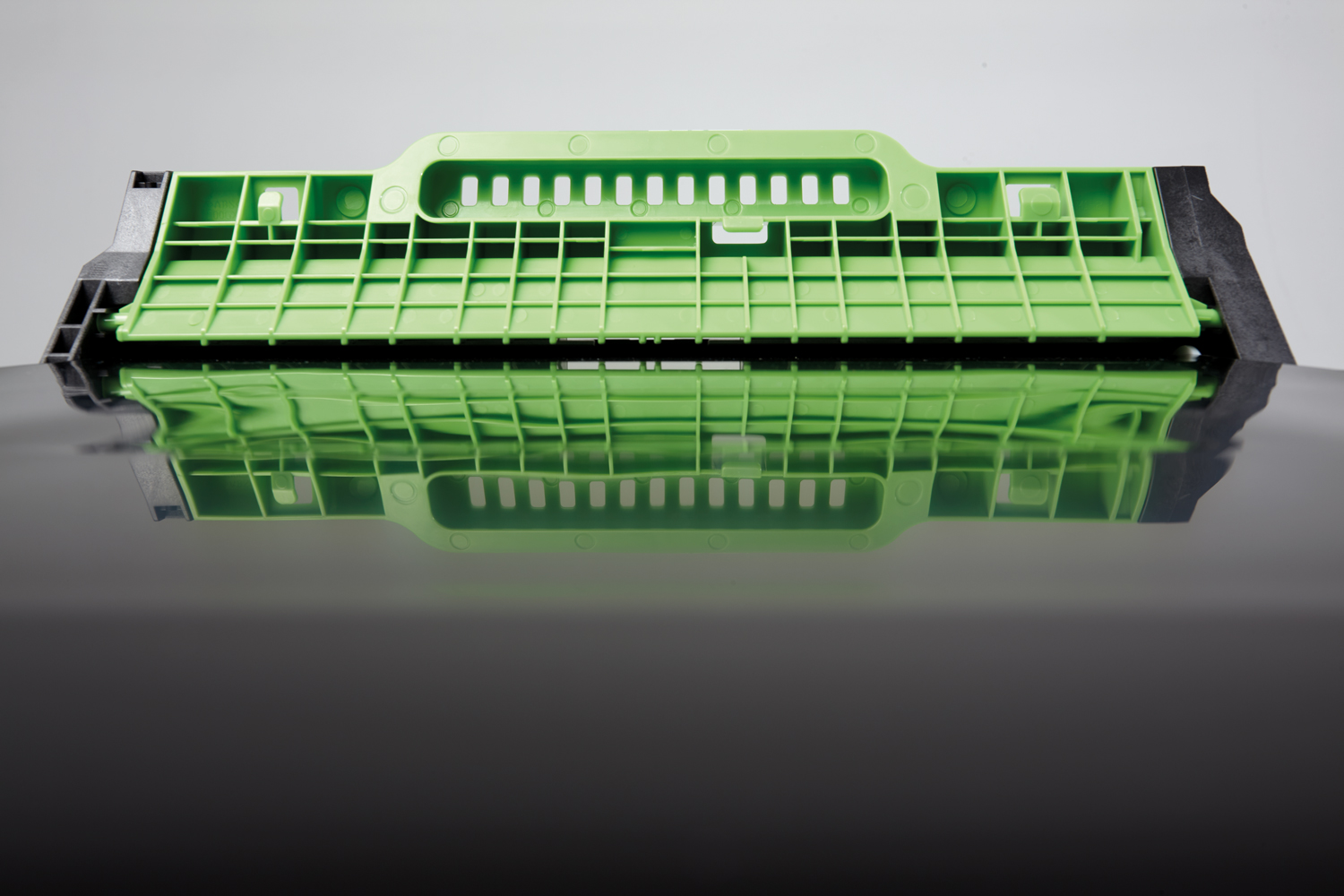 The electrostatic component in a Brother printer that resembles a swimming pool