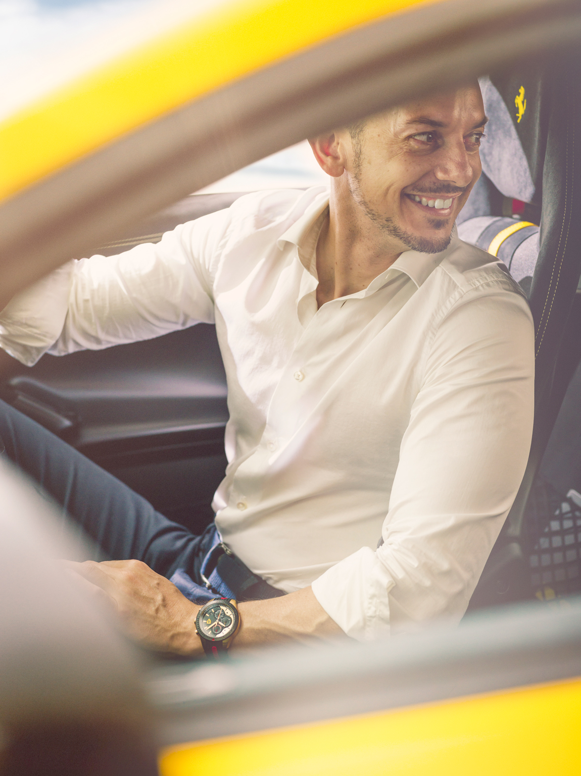 Martin Berry is wearing the Scuderia Ferrari Red Rev Evo watch