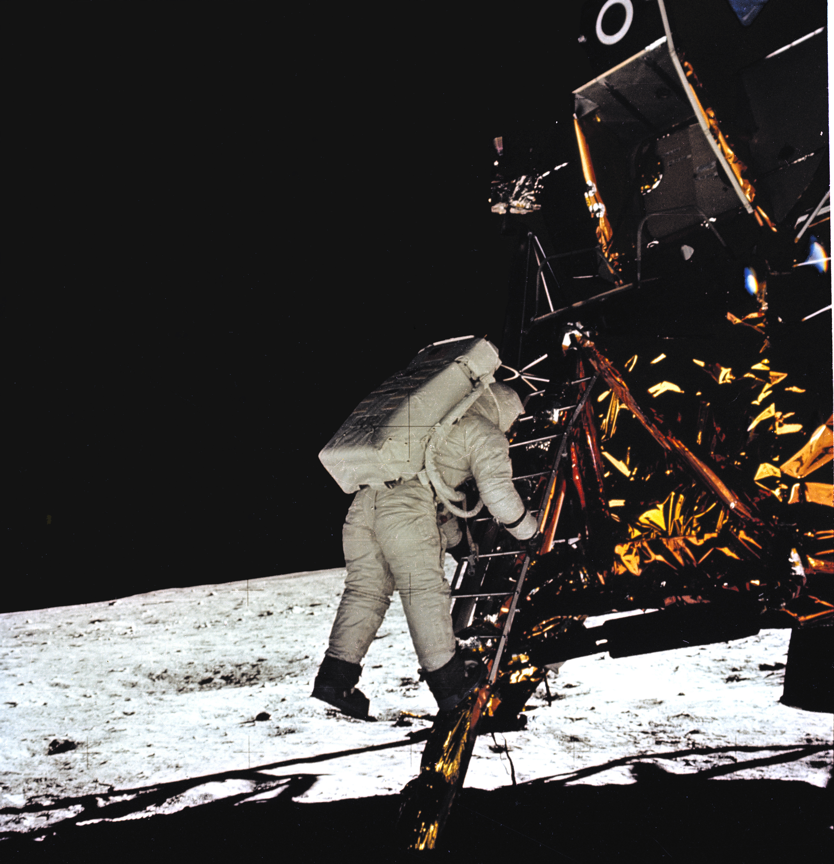 Astronaut Buzz Aldrin slowly descends down the steps of the Eagle lunar lander