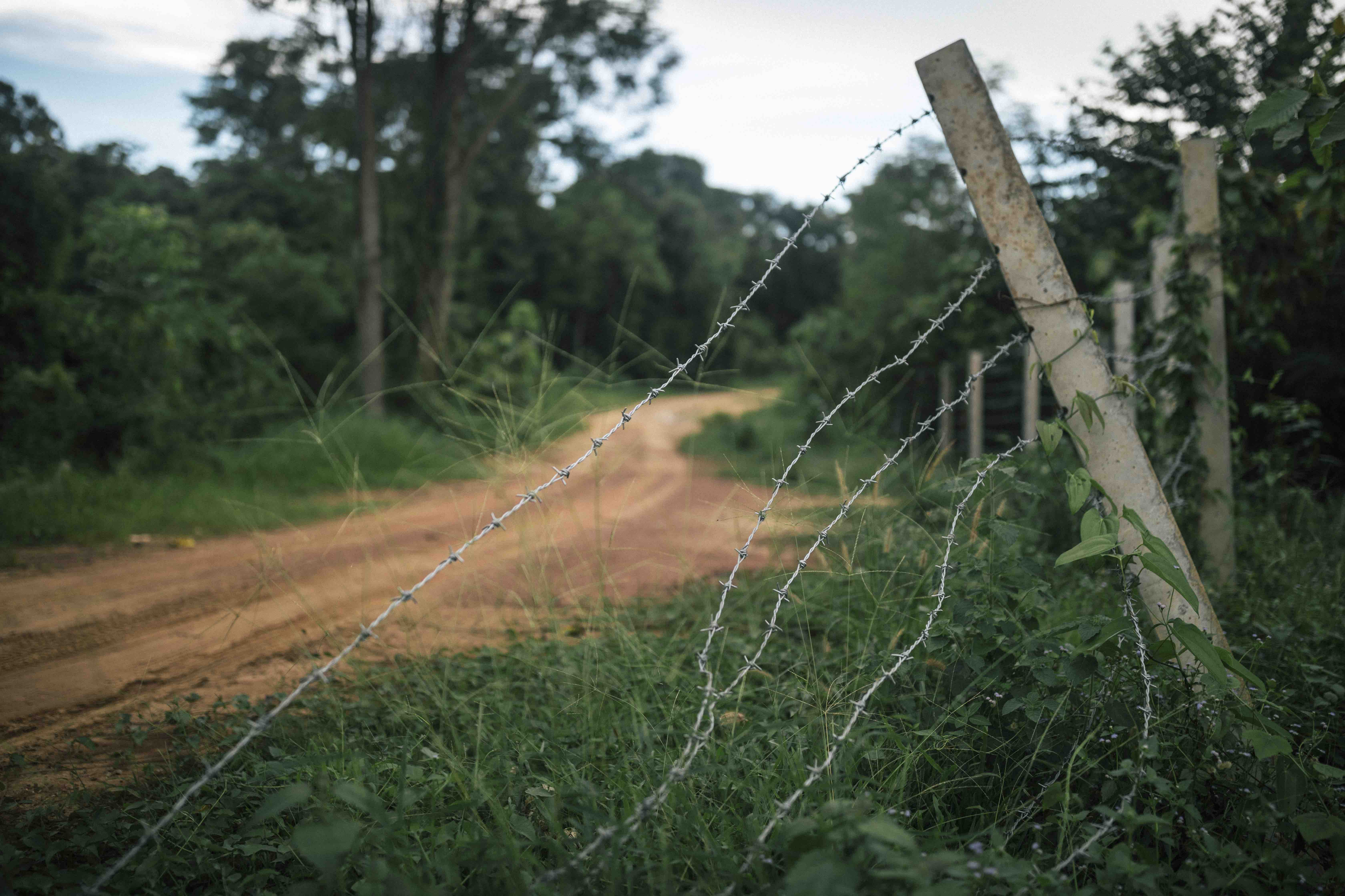 Broken fencing and torn up land near small watering holes where the elephants like to gather in Khao Yai. The barbed wire fencing does little to deter the animals.
