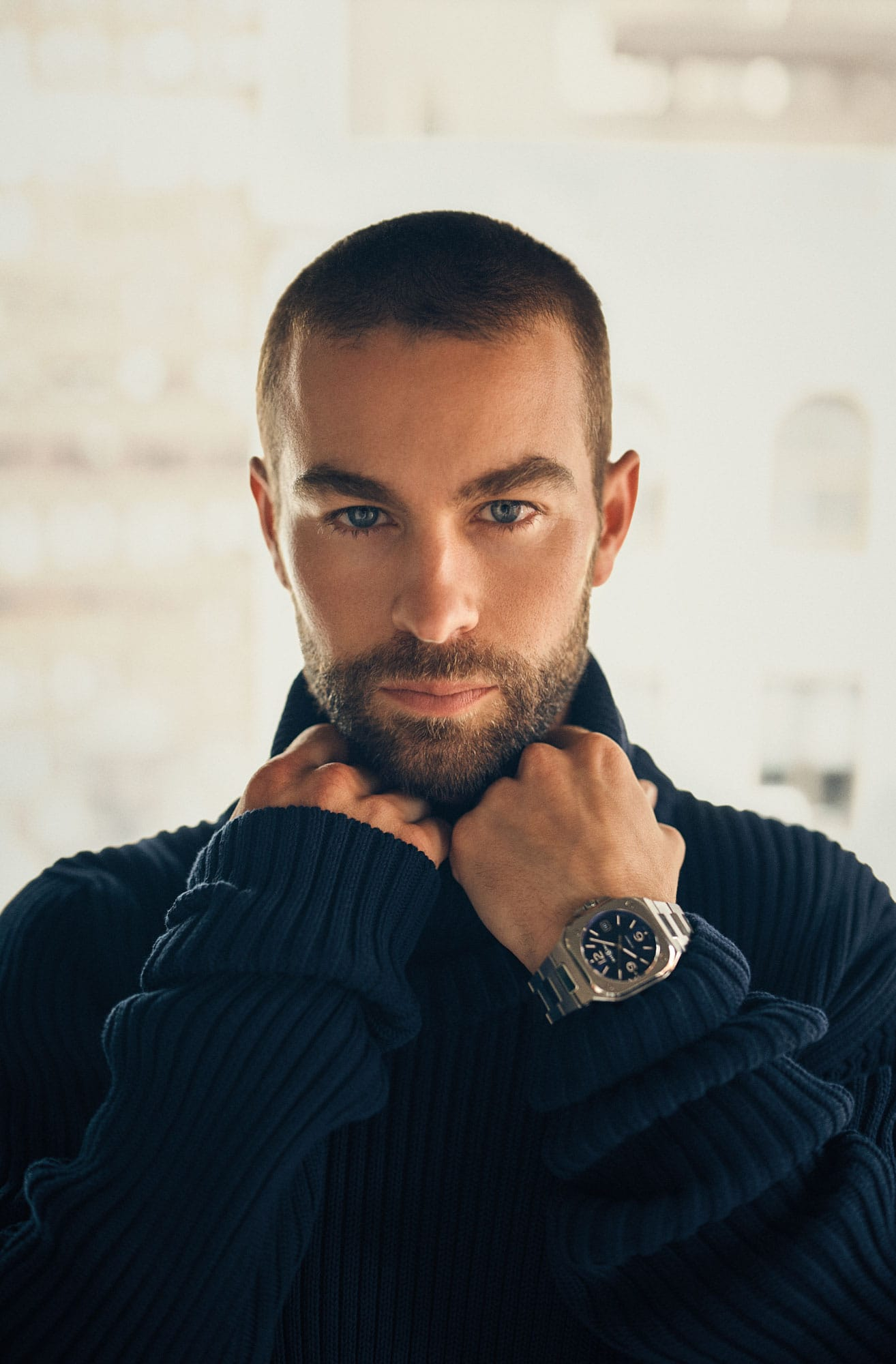 Chace Crawford is wearing a turtleneck from Bottega Veneta and the Bell & Ross BR 05