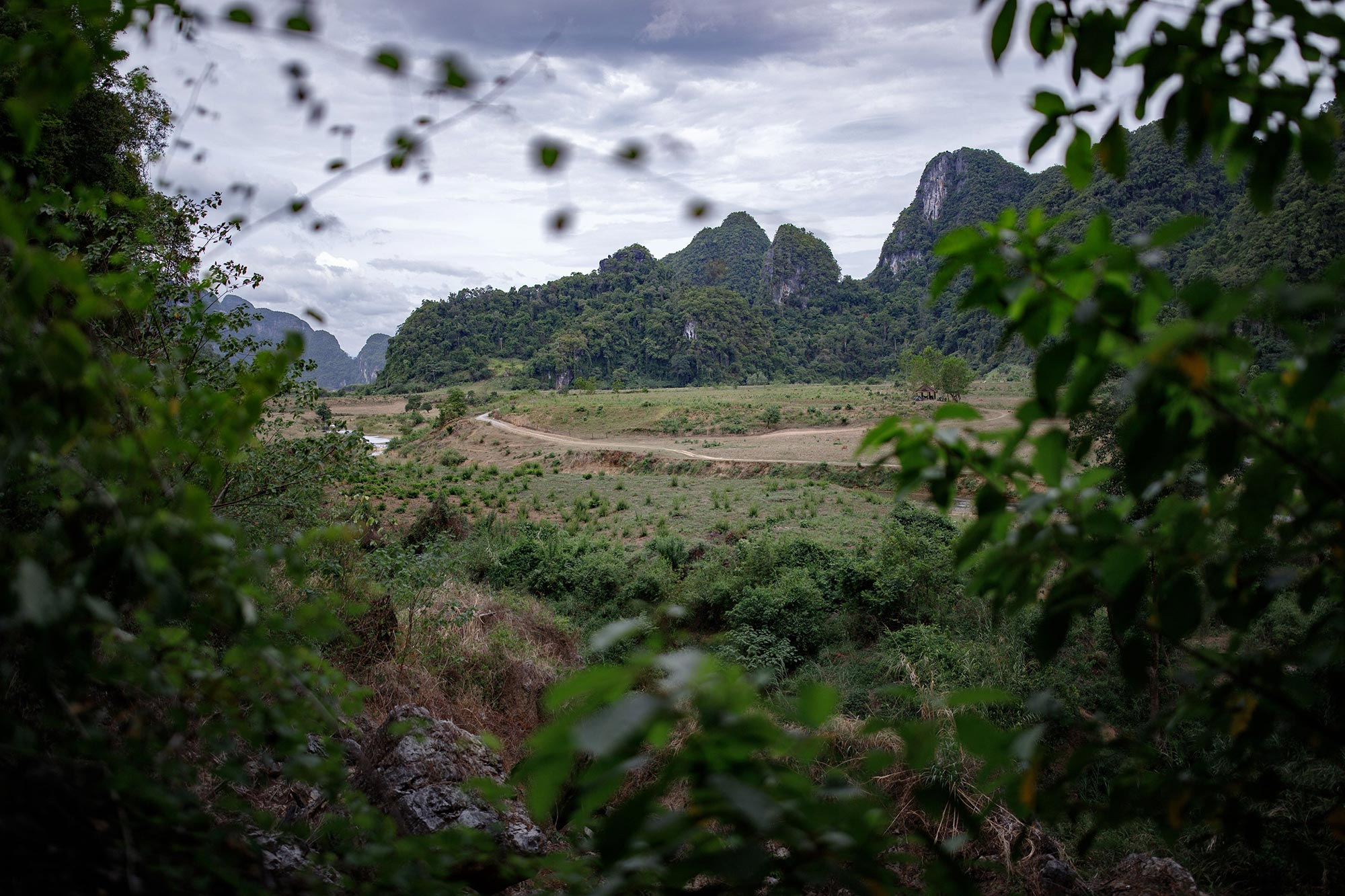 The picturesque landscape surrounding the village of Tan Hoa, where the Tú Làn cave system adventure tour begins