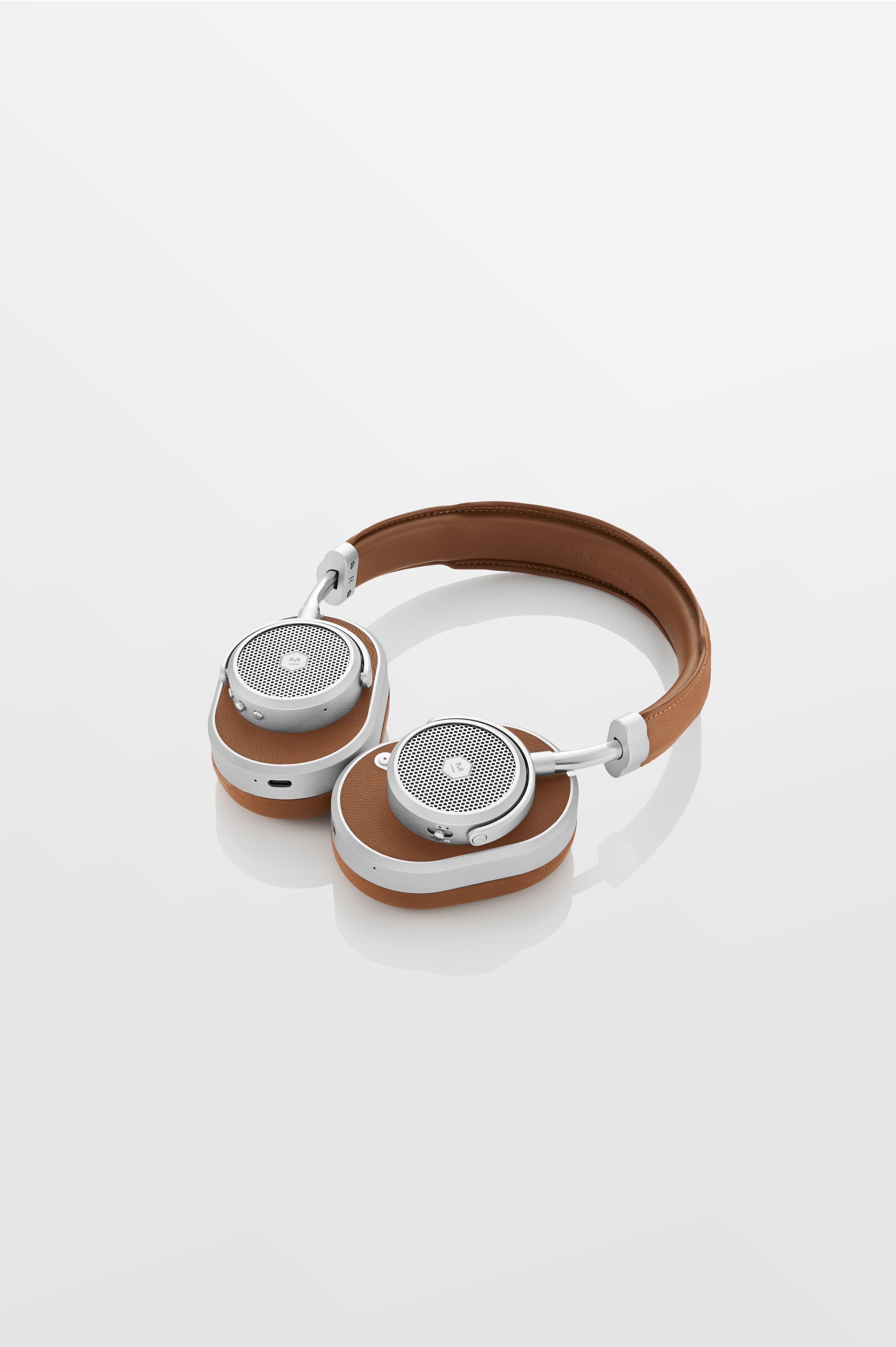 The Master & Dynamic MW65 in brown leather and silver aluminium