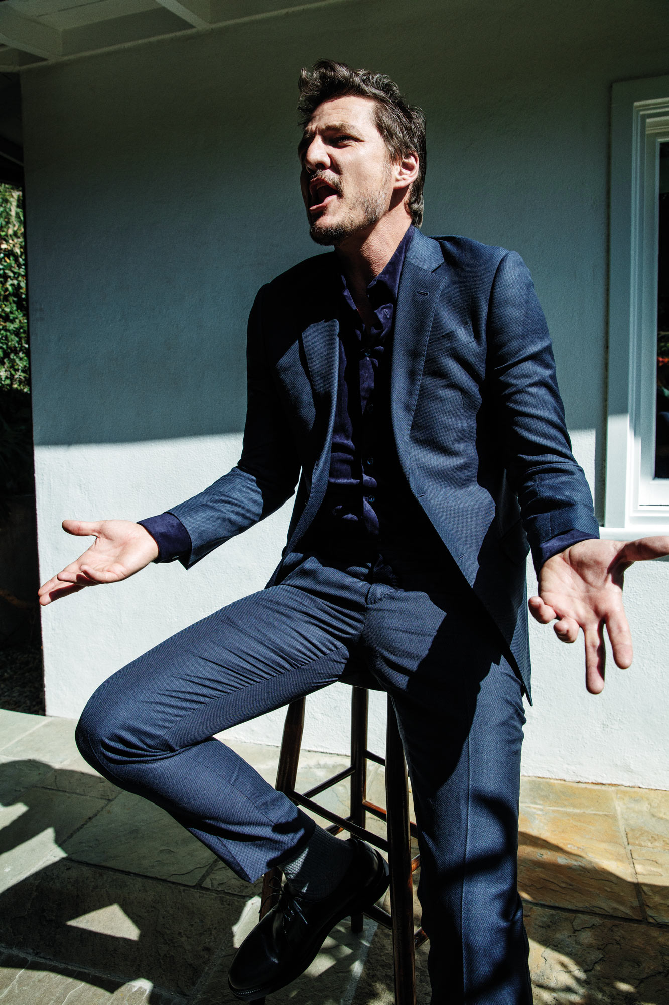 Pedro Pascal Pascal is wearing Giorgio Armani's cotton shirt and wool suit and Canali's calf-leather shoes.