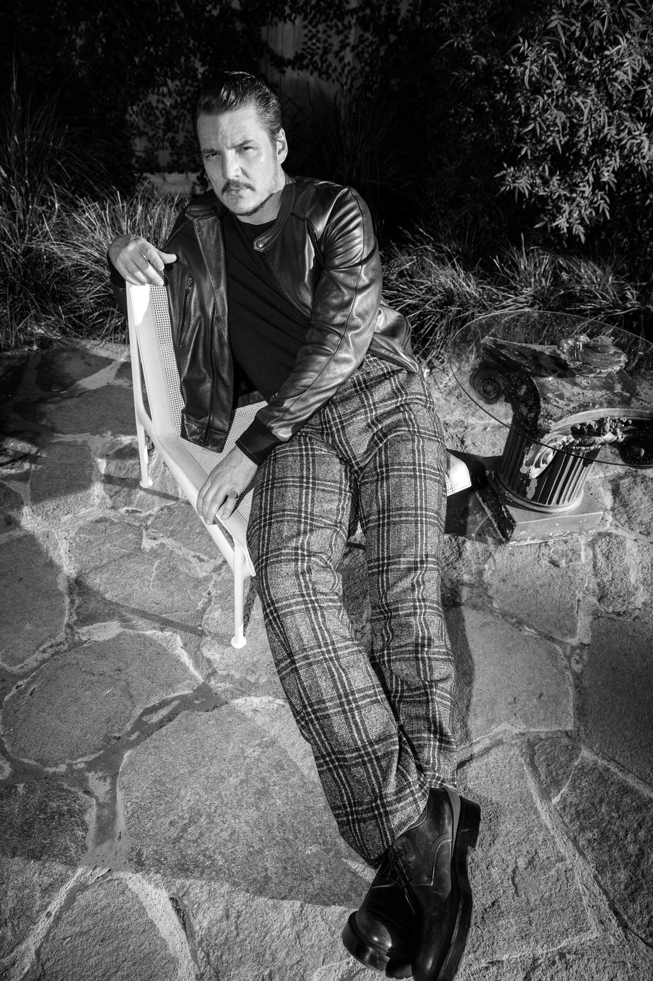 Pedro Pascal is wearing calf-leather jacket, wool trousers, both Dolce & Gabbana; cotton T-shirt, Levis; calf-leather shoes, BOSS; ring, Gabriela Artigas.