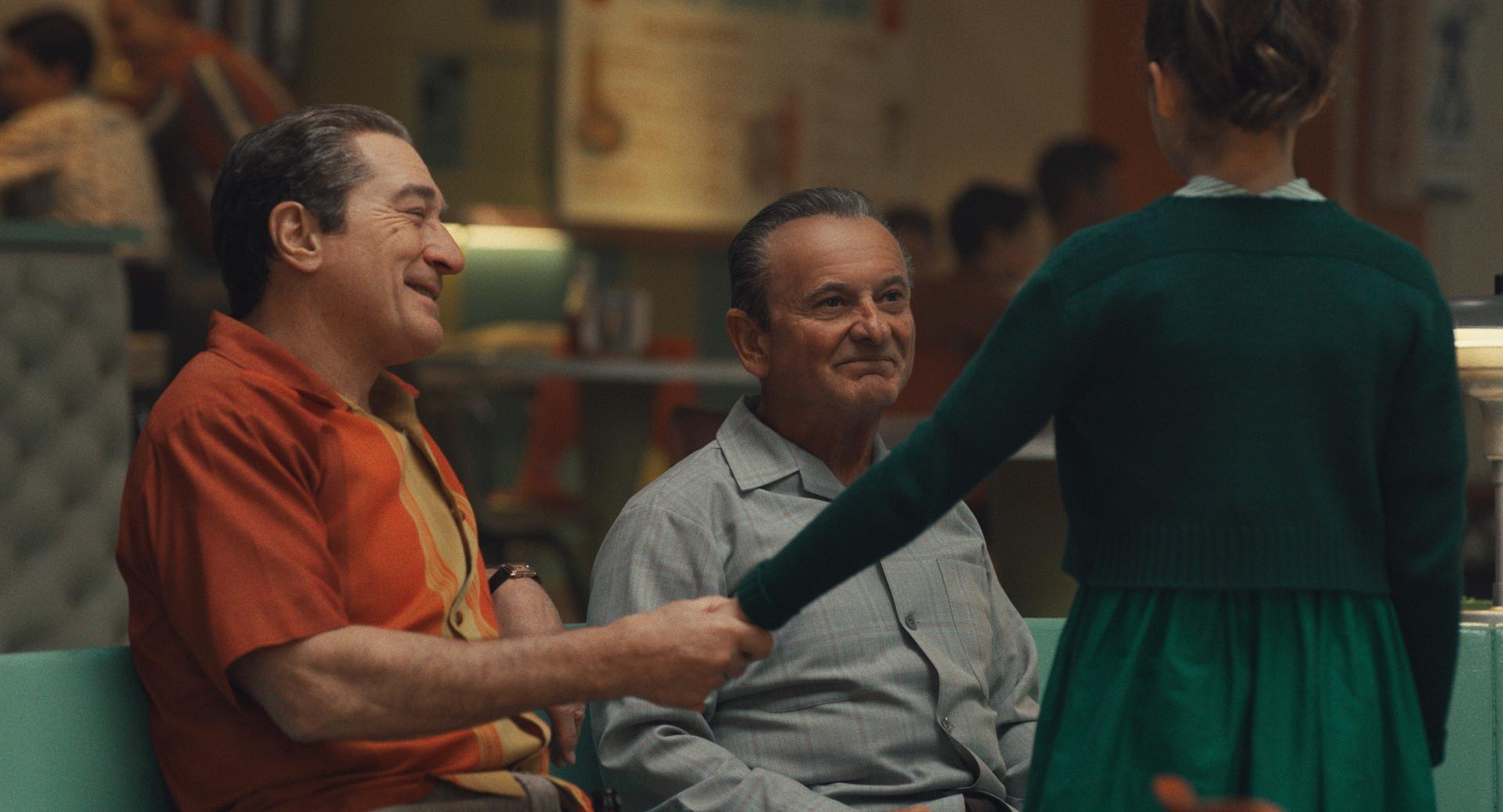 The Irishman: Joe Pesci (Russell Bufalino) and Robert De Niro (Frank Sheeran) at a bowling alley with their family