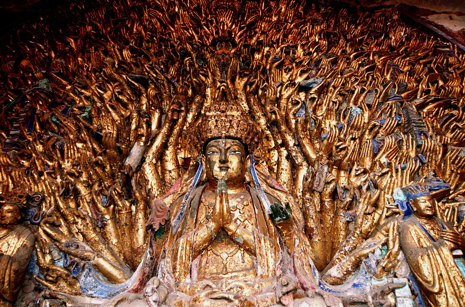 Chongqing travel guide: A religious sculpture at Dazu Rock Carvings.