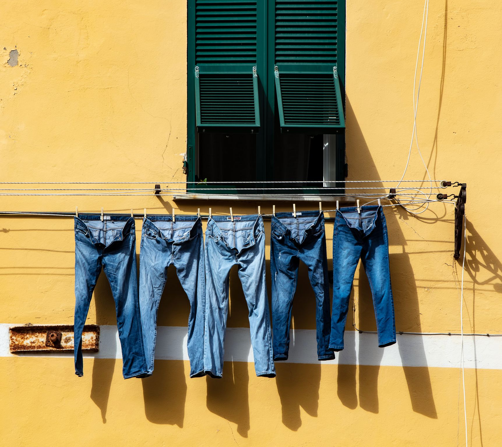 Denim jeans hanging out to dry
