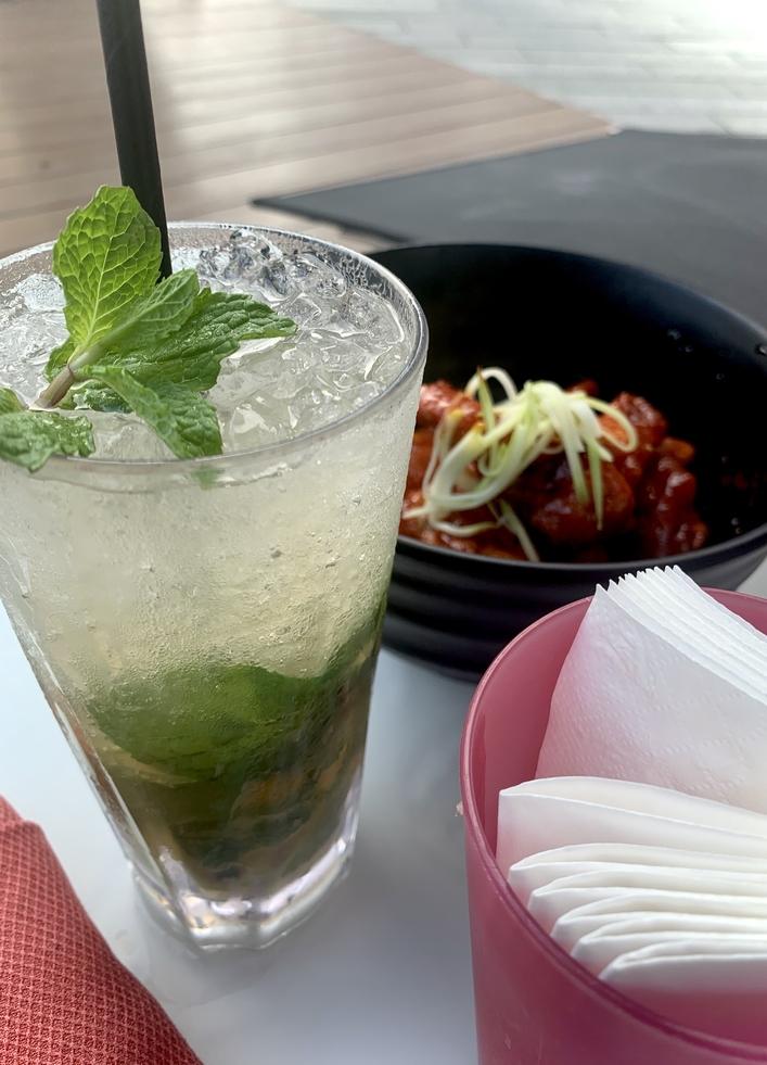 Poolside refreshments: Mojito and Korean chicken bites