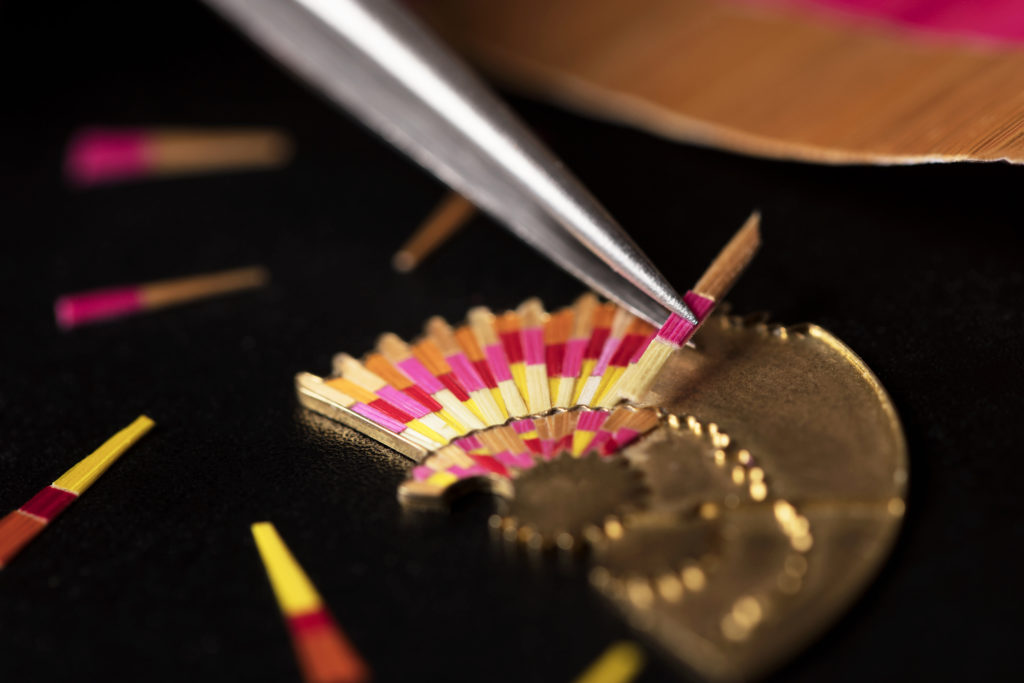 Intricate feathers composed using gold-leaf threads
