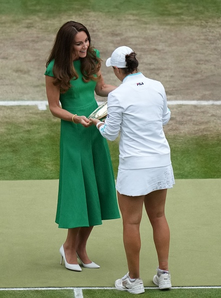 Australia's Ashleigh Barty receives the trophy from Britain's Catherine, Duchess of Cambridge, after defeating Czech Republic's Karolina Pliskova during their women's singles final match on the twelfth day of the 2021 Wimbledon Championships at The All England Tennis Club in Wimbledon, southwest London, on July 10, 2021. - RESTRICTED TO EDITORIAL USE (Photo by Mike Hewitt / POOL / AFP) / RESTRICTED TO EDITORIAL USE (Photo by MIKE HEWITT/POOL/AFP via Getty Images)